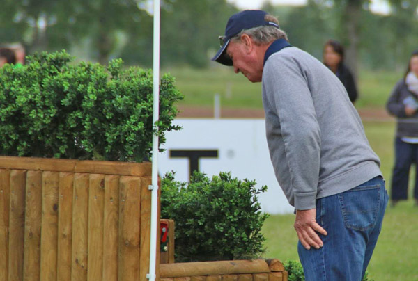 Course designer Mark Phillips inspects the frangible device on the Ariat fence during the CCI4* cross-country.