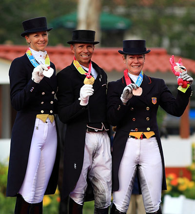 US claimed team gold and all the individual medals in Dressage at the 2011 Pan-American Games in Guadalajara, Mexico. Pictured at the individual prize-giving, from left, is Heather Blitz (silver), Steffen Peters (gold) and Marisa Festerling (bronze).