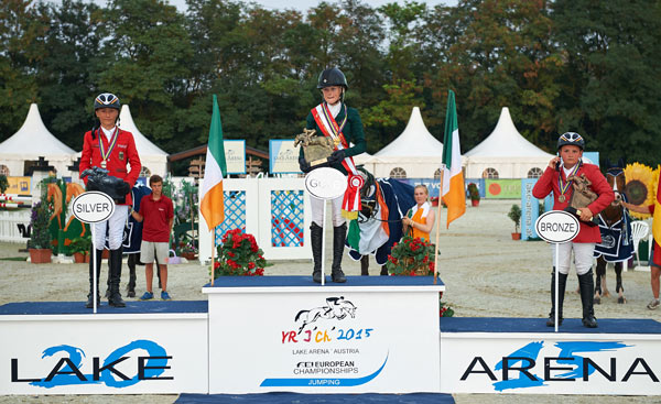 Ireland's Jennifer Kuehnle won Children's Individual Championship gold. while German riders  Calvin Bockmann, left, won silver, and Piet Menke took out the bronze medal.