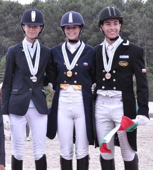 Junior individual gold medalist Katerina Tsvetanova is flanked by silver medalist Stephanie Nesheva and bronze medalist Zdravko Trenev.