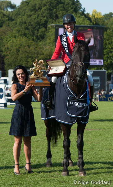 Beezie Madden and Cortes 'C' receive the Longines King George V Gold Cup for the second consecutive year.