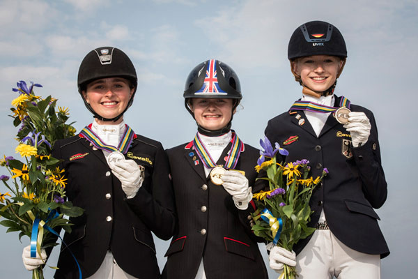 Individual Dressage winners at the FEI European Pony Championships in Malmo, Sweden; from left, silver medalist Nadine Krause (GER), gold medalist Phoebe Peters (GBR) and bronze medalist Helen Erbe (GER).