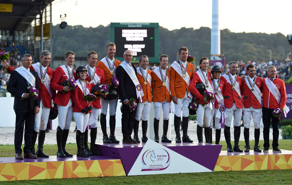 The winning European Championships Jumping teams on the podium, from left, Germany (silver), The Netherlands (gold), and Switzerland (bronze).