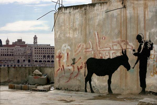 "Banksy's ""Donkey Documents"" work on a wall in Bethlehem. Photo: Julien's Auctions website"