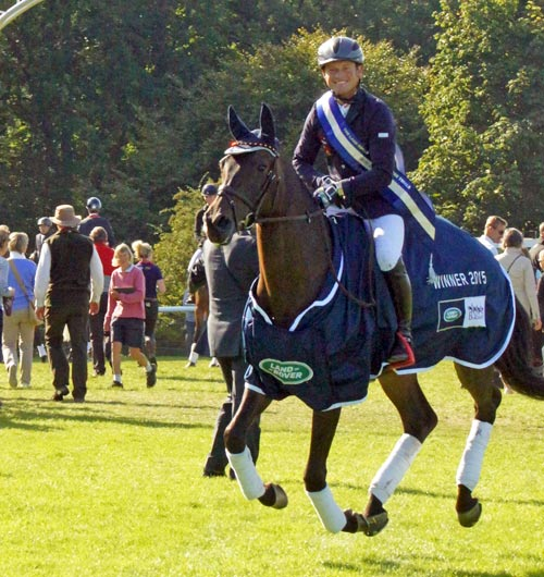 Michael Jung and La Biosthetique Sam on their lap of honor after winning the Burghley Horse Trials.