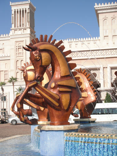 The equine fountain at the front of Al Qasr was created bySouth African sculptor Danie de Jager, as were the above golden arabian horses.