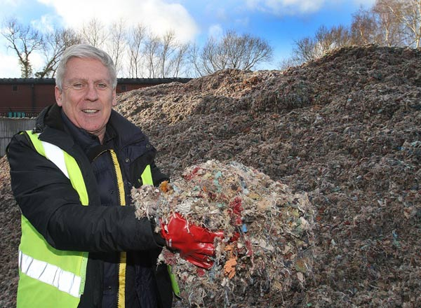 Potter Group Carpet Recycling Centre Manager Keiran McCabe with some of the fibre produced at the Newtown plant.