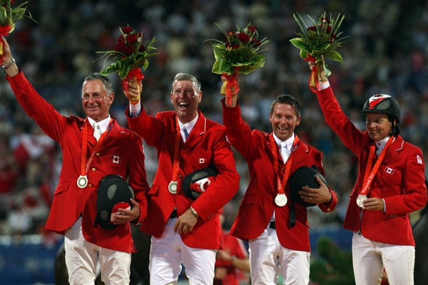 Ian Millar, second from left, helped Canada win team silver at Beijing 2008.