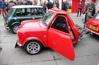 A mini converted into a trailer. The 'headlamps' have red bulbs.