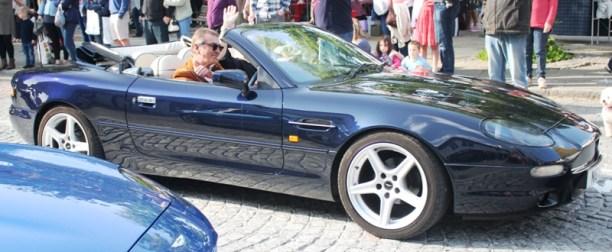 Aston Martin driving away