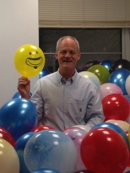 Bryce showing off his office brimming with balloons to celebrate his retirement. Balloons were snuck in by undergrads in the Hort Club