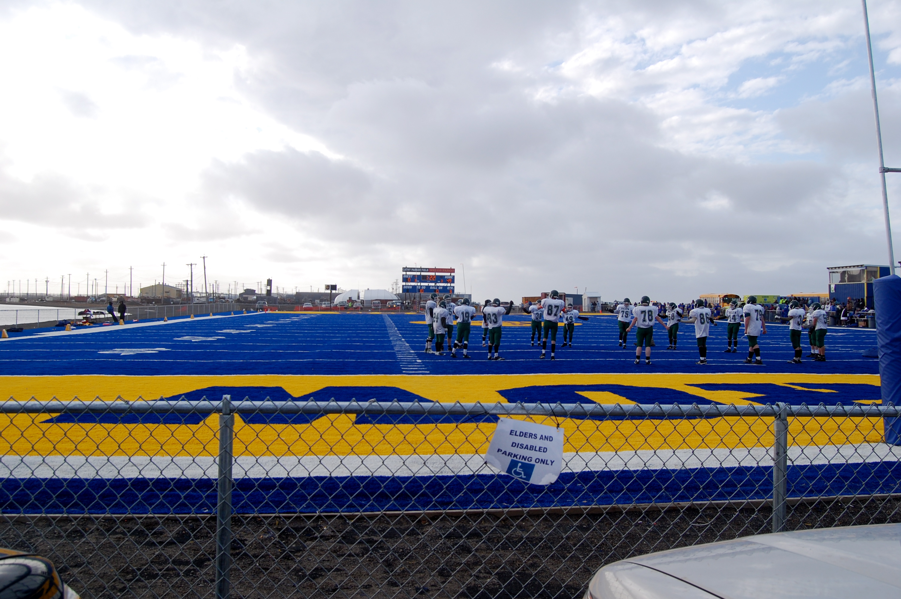 The football field is made entirely of astroturf and it is probably 20 yards from the Arctic Sea.  When the Barrow Whalers win a game the entire team take a dip in the water!