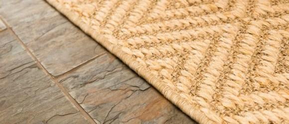 slate flooring with sisal rug