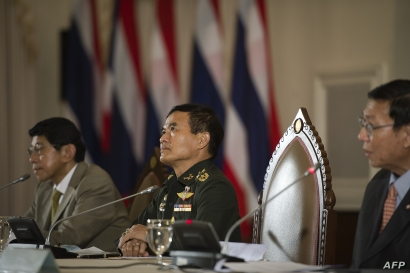 FILE - Members of the National Council for Peace and Order, from left, Wissanu Krea-ngam, General Paiboon Khumchaya and Pornpetch Wichitcholchai speak during a press conference at Government House in Bangkok, July 23, 2014.