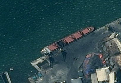 This satellite image from the Department of Justice shows what it says is the North Korean cargo ship Wise Honest docked at an unknown port. The Trump administration has seized the North Korean cargo ship used to supply coal in violation of international sanctions, May 9, 2019.