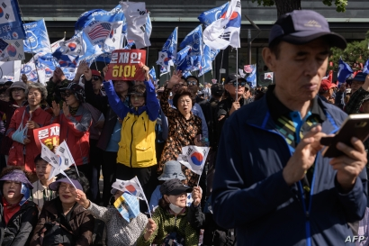 Anti-government activists attend a rally in central Seoul on October 9, 2019. - The protesters were calling for South Korea's…
