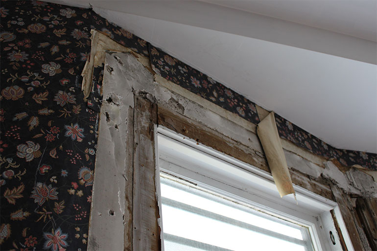 Wooden trim from windows and doors has been removed and will find new life in another project.