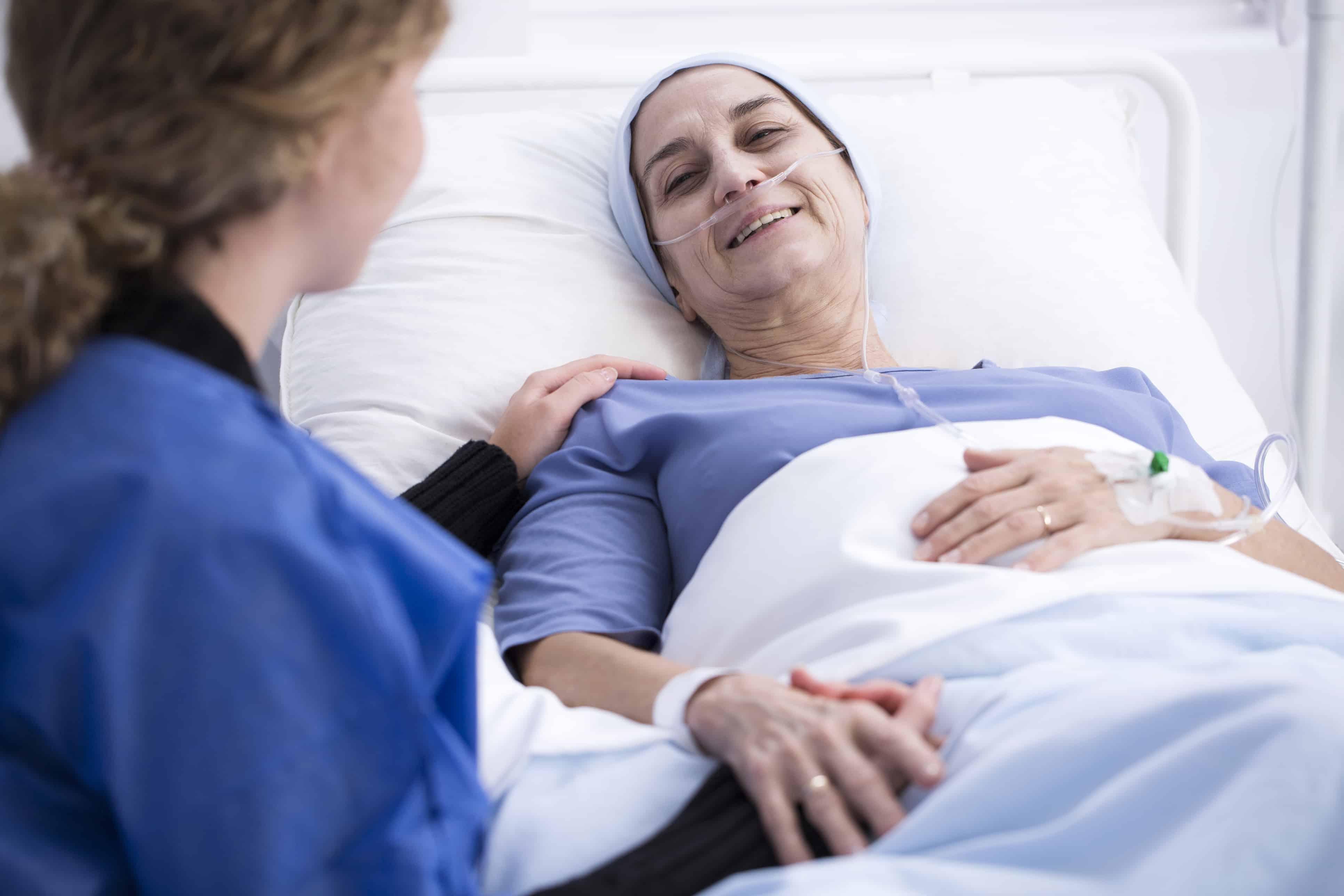 Hospice nurse next to a hospice patient