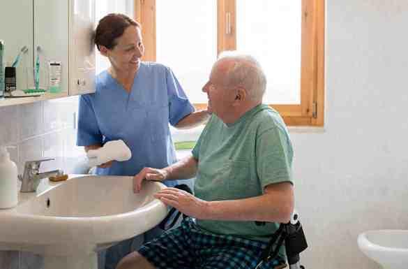Nurse bathing hospice patient