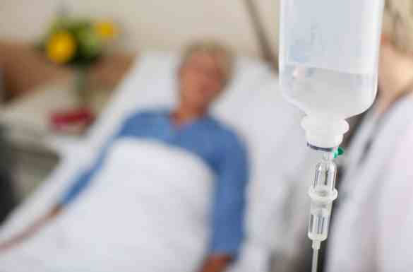 Hospice patient laying down receiving artificial nutrition and hydration