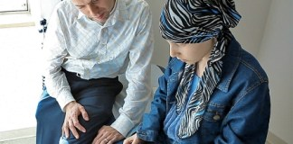 """Olivia Santarelli and Dr. Paul Nathan, SickKids Oncologist experiment with the new """"Pain Squad"""" Application."""