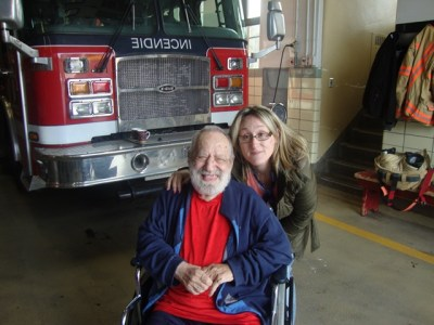 Jewish Eldercare resident Gerald Reinharz visiting the fire station with Recreation Specialist Josie DiBenedetto.