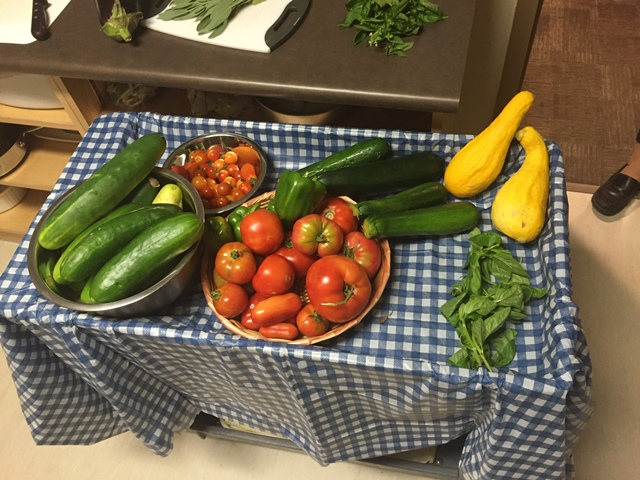 The group gathered to make a meal from the vegetables they grew in their garden