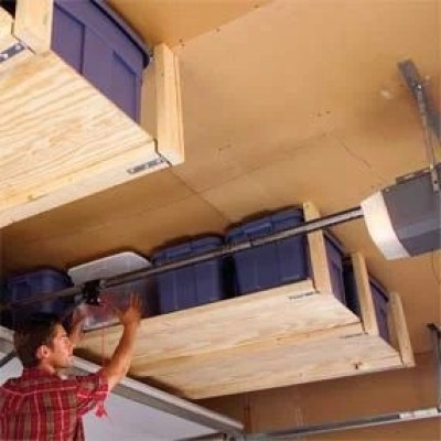 Suspended Shelving {to store bins over the garage door}