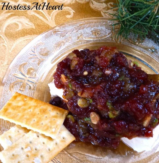 Festive Cranberry Cheese Spread is an easy appetizer to put together and elegant enough to serve at your next gathering. It's perfect to make in a jiffy and easy to share. - HostessAtHeart.com