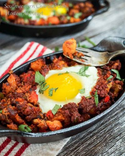 Southwestern Chorizo Hash is a easy and delicious recipe that is perfect for any meal of the day. It's spicy and topped with a beautiful poached egg   HostessAtHeart.com
