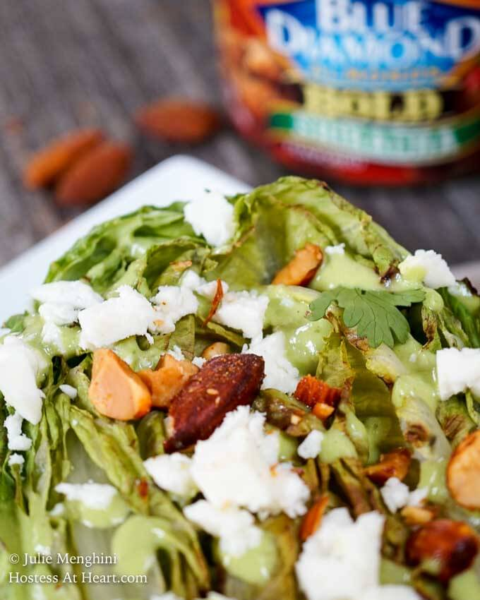 Southwestern Grilled Romaine Salad is toppedwith a delicious creamy avocado cilantro dressing, Queso Blanco cheese, and Blue Diamond Bold Sriracha almonds. These nuts add a great crunch to an already delicious salad.   HostessAtHeart.com