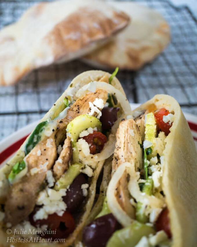 A quick and easy delicious Chicken Gyro recipe. You can either stuff the ingredients into a pita or make a healthy Greek salad.   Hostess At Heart-1