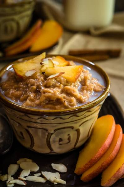 Crockpot Steel Cut Oats & Bulgur in a dish topped with milk and peaches