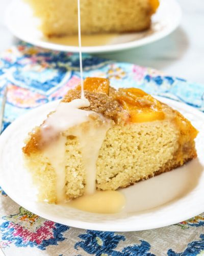 Upside-Down Peach Cake with Hot Rum Sauce is one of the most amazing cakes I've ever eaten. There's nothing like the combination of brown sugar, peaches, and warm rum. | HostessAtHeart.com