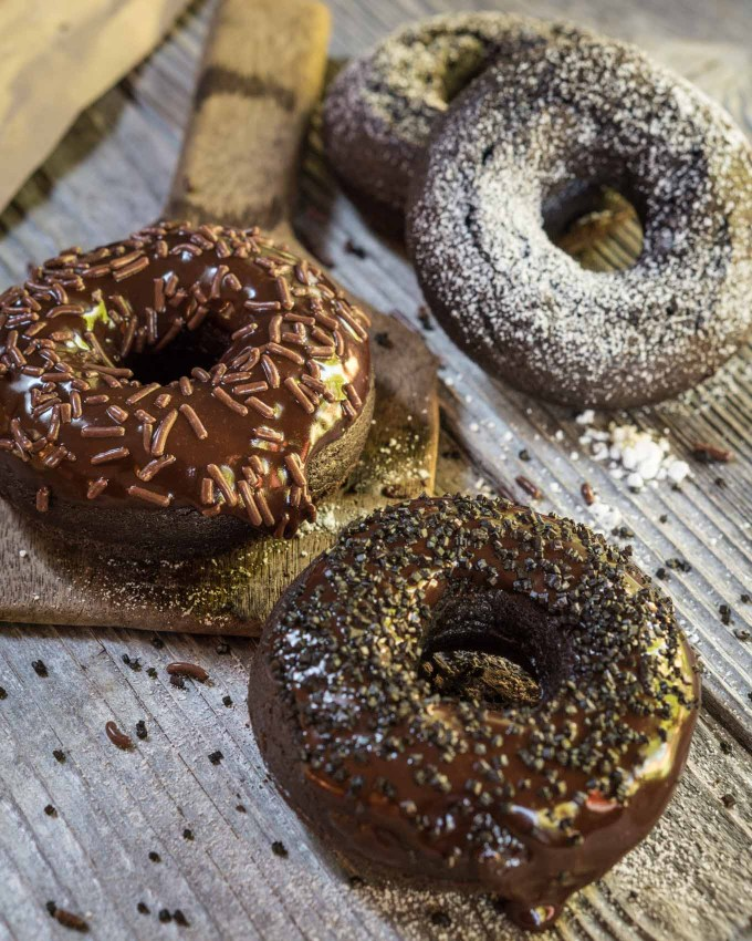 Dark Chocolate Baked Donuts are chocolatey, tender and fluffy. They're great for breakfast and baking doesn't sacrifice taste.   HostessAtHeart.com