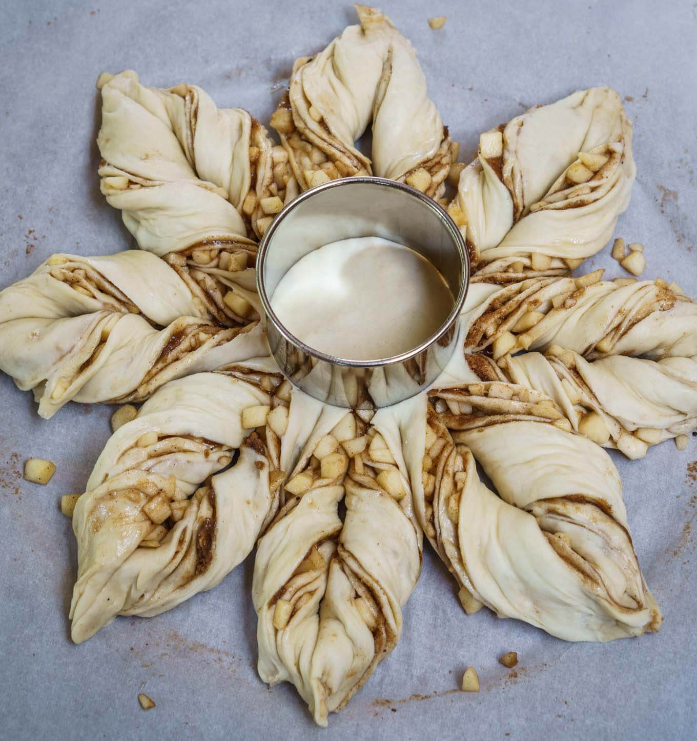 Spiced Apple Star Bread is so good you can eat it with a meal or as a dessert. It's a sweetened buttery, bread that's tender and warm from the fall spices. This bread looks hard to make, but it's easier than you think.   HostessAtHeart.com