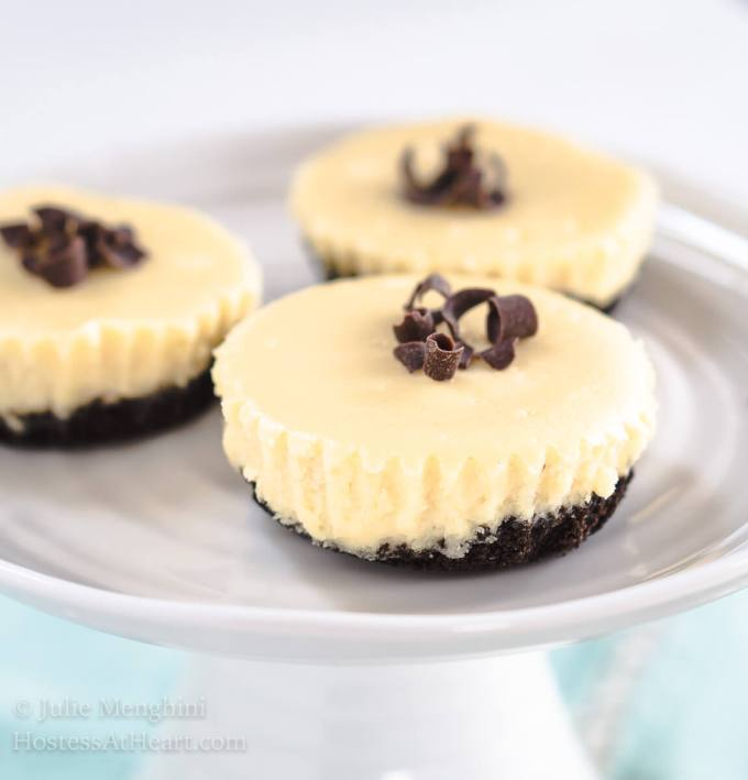 Decadent Chocolate Caramel Baileys Mini Cheesecakes are so creamy and luscious.  They are the perfect for casual or fancy entertaining, but there isn't anything fancy about putting them together! | HostessAtHeart.com