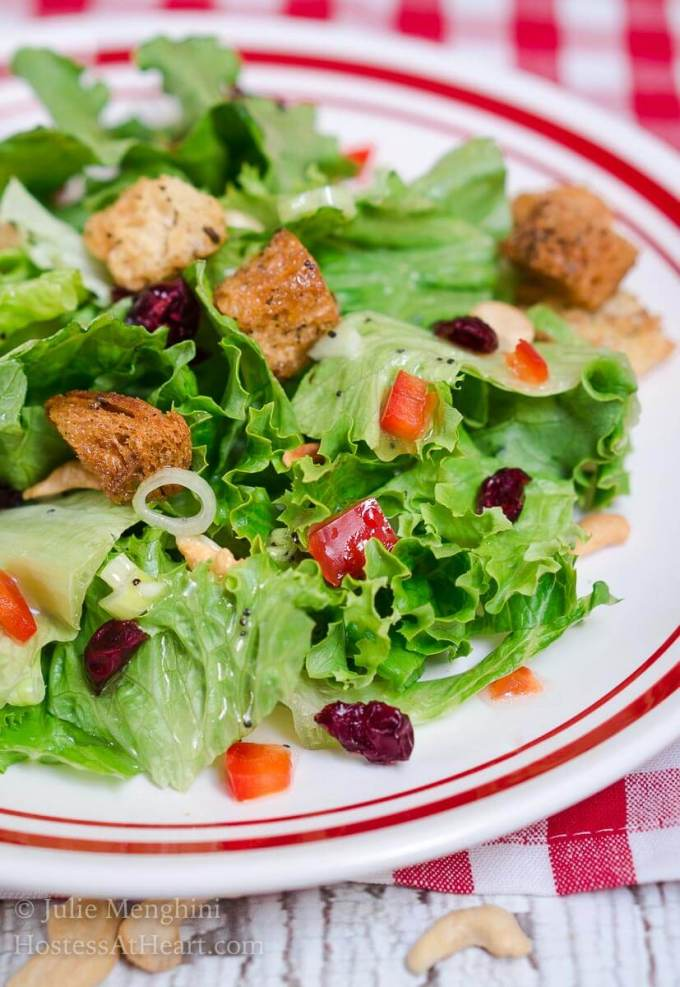 Favorite Green Salad with Sweet Poppyseed Dressing is the perfect salad to make and take or just have on hand for a delicious lunch! | HostessAtHeart.com