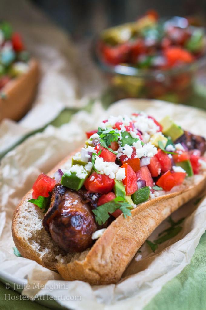 Take back dinner time!  Chipotle Bacon Wrapped Brats with Avocado Pico are quick, easy and best of all delicious!