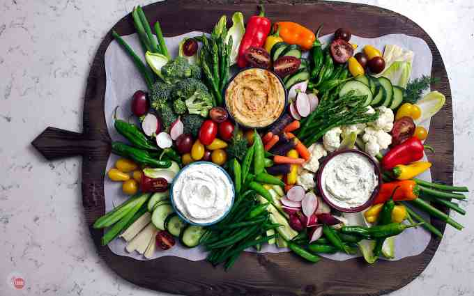 A beautiful Crudite Tray filled with vegetables and dips perfect for any gathering.