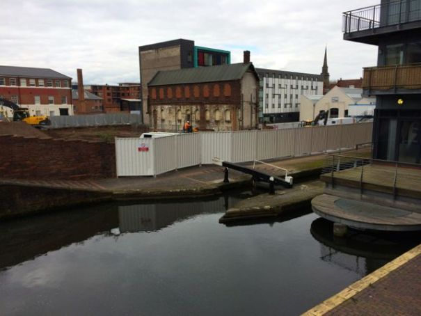 Barrier erected along canal side
