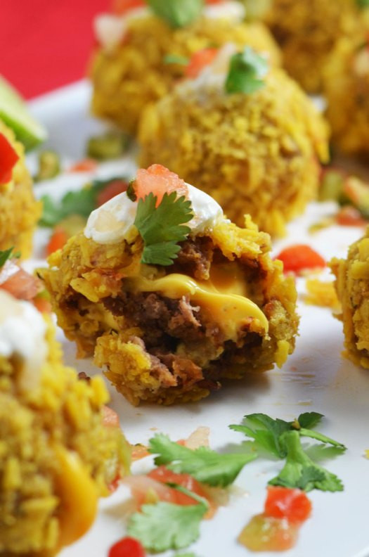 Loaded Nacho Bombs. All of the best nacho flavors in bite-sized balls. Perfect for a Super Bowl party or pot luck! | hostthetoast.com