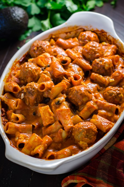 Enchilada Meatball Pasta Bake. This simple, saucy, cheesy dinner comes together all in one dish-- no pre-browning the meatballs or pre-boiling the pasta necessary.   hostthetoast.com