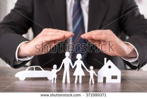 man with hands hovering above a paper cut out family