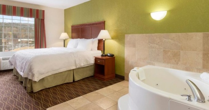 King suite with a private hot tub in the room in Hampton Inn & Suites Greenfield, MA hotel