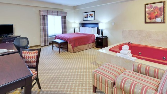 studio suite with a private whirlpool tub inside the room in Country Inn & Suites by Radisson, Absecon (Atlantic City) Galloway, NJ hotel