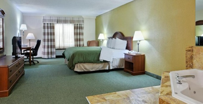 Suite with a spa tub in the room in Country Inn & Suites by Radisson, Charlotte University Place, NC
