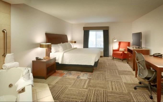 Suite with a hot tub in the room in Hilton Garden Inn Salt Lake City-Sandy, Utah