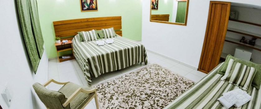 Imagem de cama de uma pousada