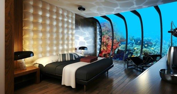 imagem interna de hotel com vidro para aquario